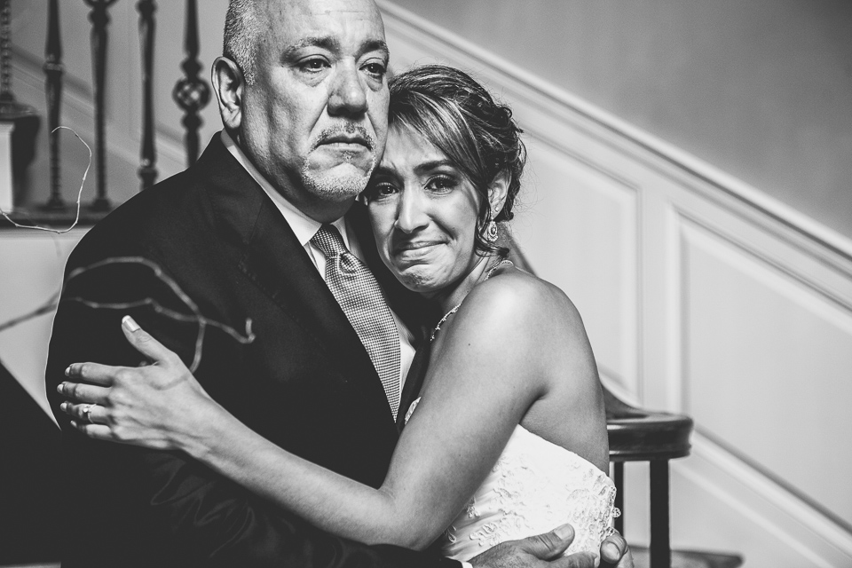 Bride and her dad crying.