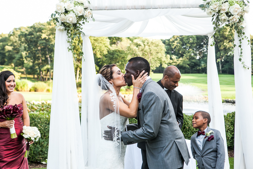 Bride and groom first kiss at Alpine Country Club, in New Jersey.