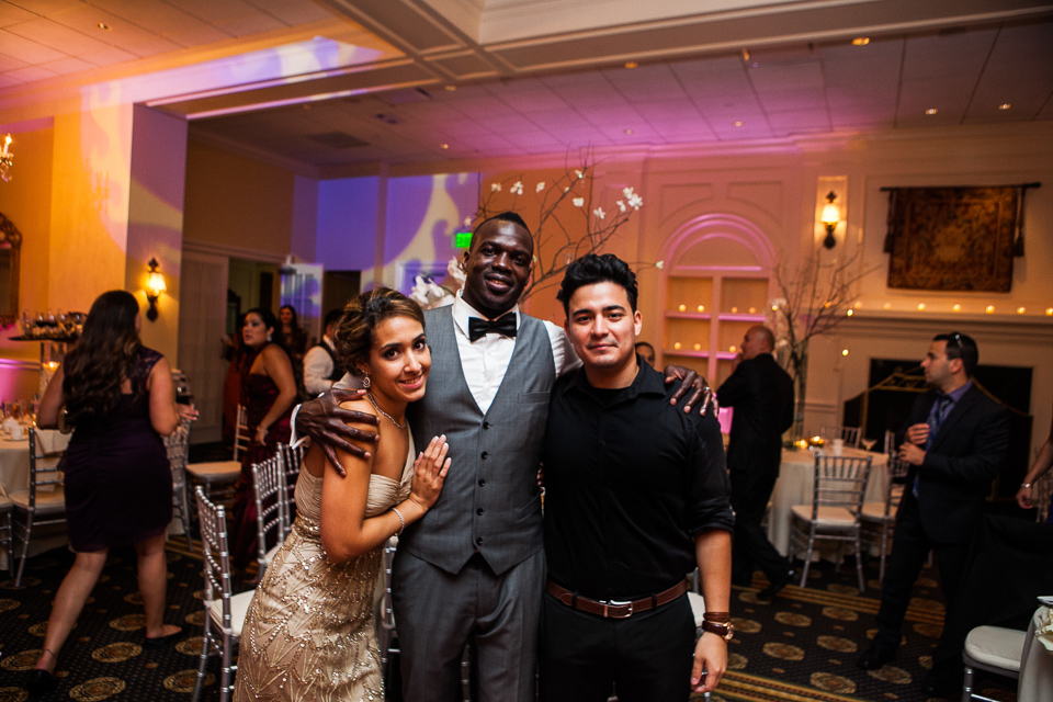 Walter Steven Vinces of Sage Studios Photography with the bride and groom at Alpine Country Club, in New Jersey.
