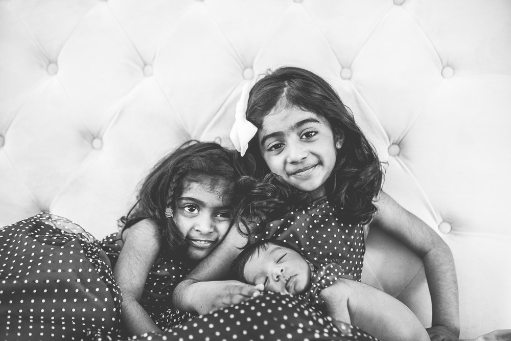 Sisters with their baby brother by Westchester wedding photographer Sage Studios Photography.