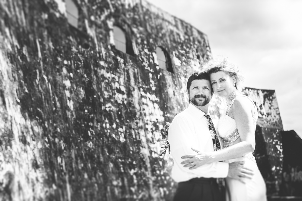 Bride and groom in black and white in Castillo San Felipe del Morro in Puerto Rico, by Westchester photographer Sage Studios Photography.