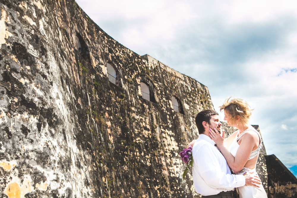 Bride and groom at Castillo San Felipe del Morro in Puerto Rico, by Westchester photographer Sage Studios Photography.