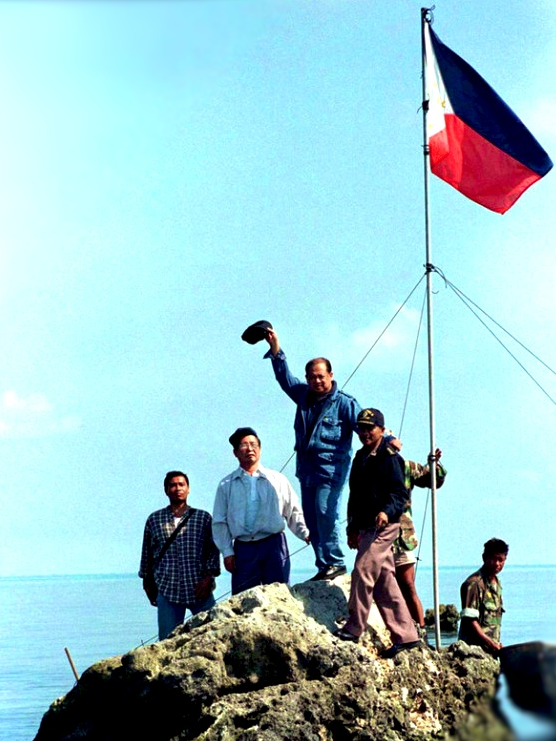 A viral photo of a group of Filipinos led by congressmen Roque Alban and Jose Yap planting the Philippine flag on the reef of Scarborough Shoal in 1997.
