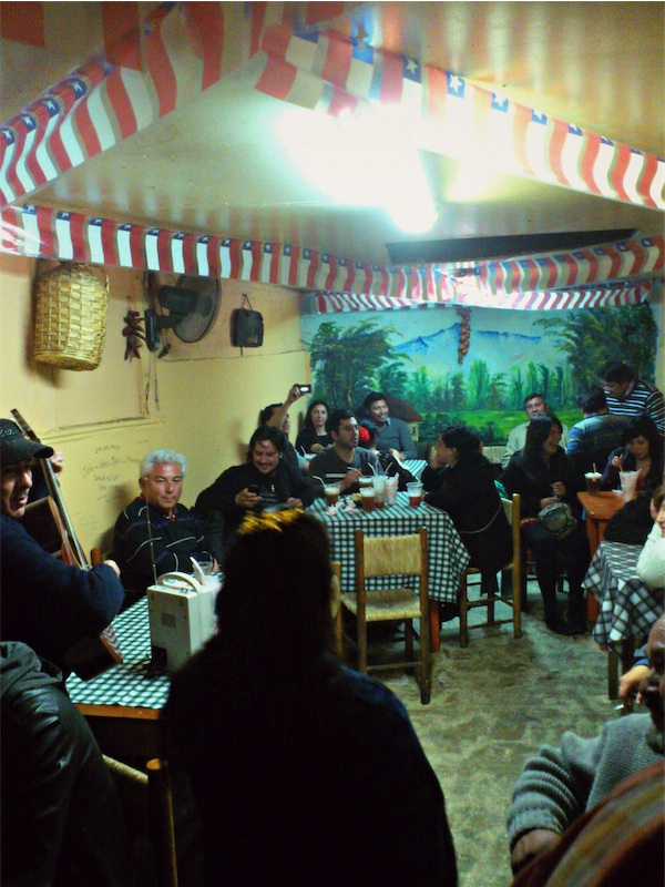 At La Piojera, a famous local bar in downtown Santiago, Chilenos from all walks of life celebrate the nation's republican spirit in wine and song.   (Photo by Migs Bassig)