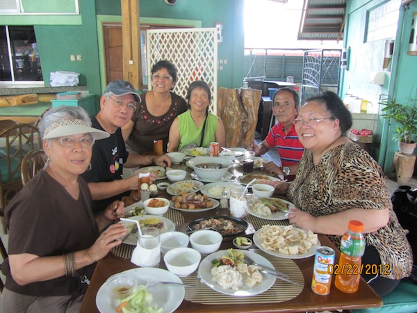 Lisa Suguitan Melnick (fourth from left) and her  Lakbay Loob  travel group, led by author Oscar Peñaranda (second from left) in one of the foodstops in Davao  (Courtesy of Lisa Suguitan Melnick)
