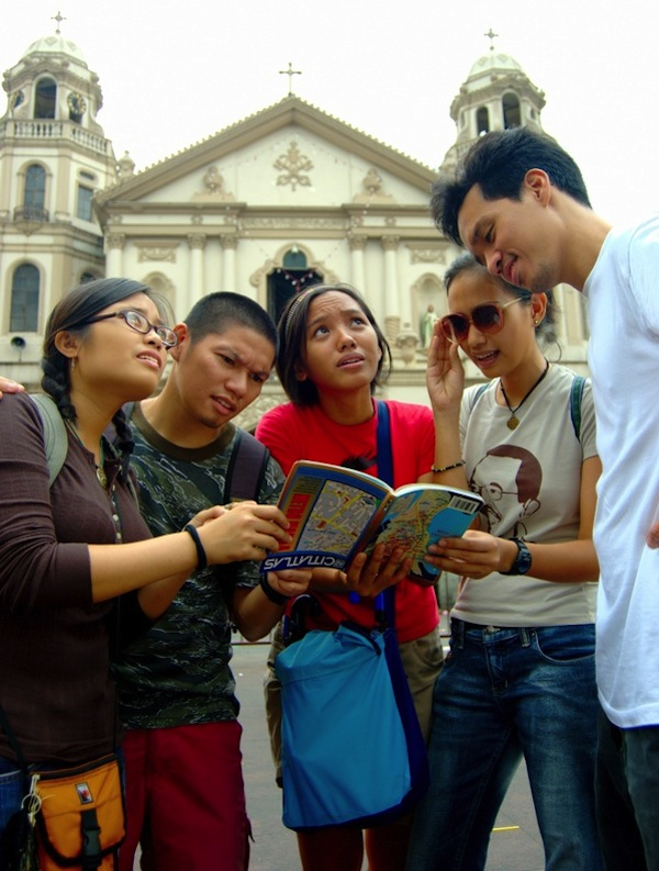 The author (second from the left) and his traveling companions (from left to right: Elle Macatulad, Raisa Casugbu, Carmela Casugbu and Raf Reyes) set out on an adventure to explore the Old City of Manila. (Photo by Kian Vicera)