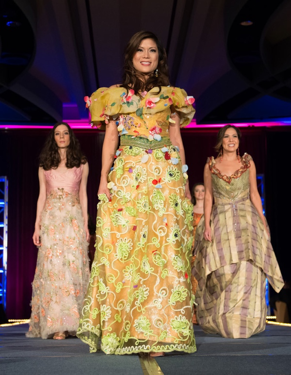 Yellow gold gown with multicolored appliques on shawl collar and yellow green passementeries or cording on skirt. A Patis Tesoro creation at the annual fashion show fund raiser of the Philippine International Aid (PIA) in San Francisco, November 2012.