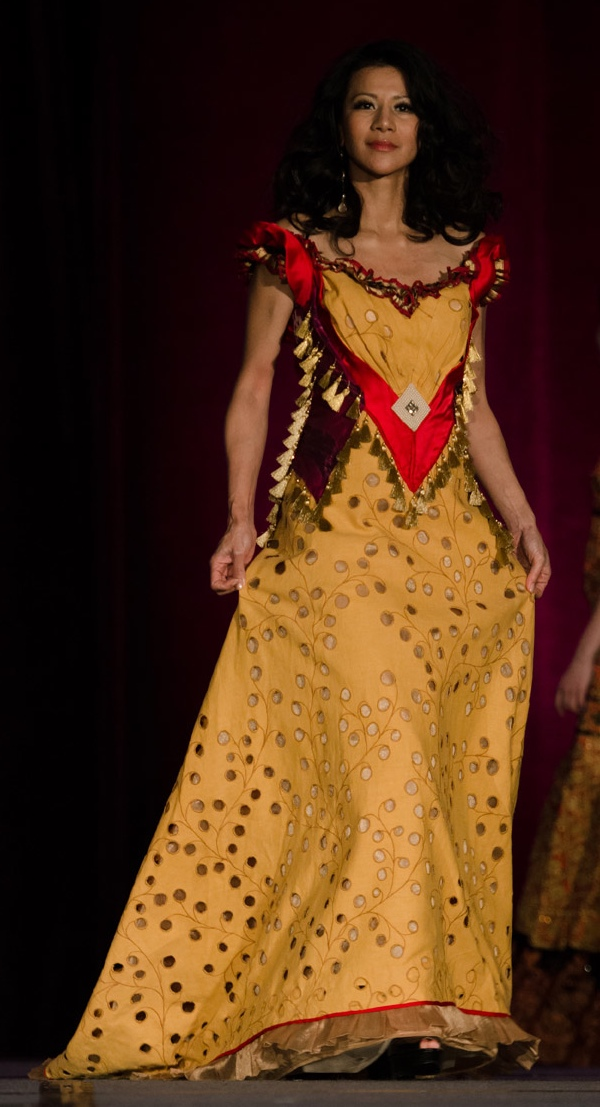 Yellow gown with greenish and red trimmings on bodice and sleeves. A Patis Tesoro creation at the annual fashion show fundraiser of  the Philippine International Aid (PIA) in San Francisco, November 2012.