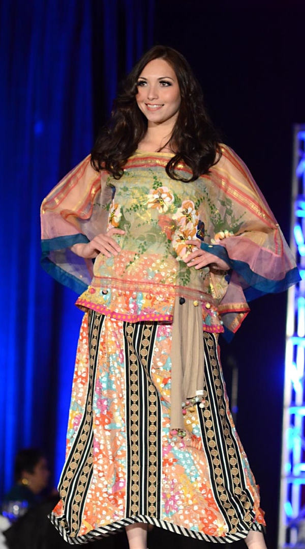 Hip-length kaftan with hand painting and horizontal stripes over an A-line midi-length skirt with ethnic multicolored panels and vertical black ethnic stripes. A Patis Tesoro creation at the annual fashion show fundraiser of the Philippine International Aid (PIA) in San Francisco, November 2012.