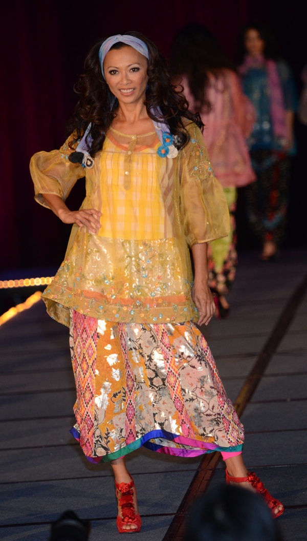 Sheer tunic with three-quarter length sleeves with ethnic inlay and a multicolored midi-length skirt. A Patis Tesoro creation at the annual fashion show fundraiser of the Philippine International Aid (PIA) in San Francisco, November 2012.