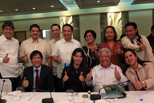 Members of the Senate and House panels, led by Senator Pia Cayetano and Representative Edcel Lagman (seated, second and third from left respectively) present the bicameral conference committee report on the Reproductive Health (RH) bill. (Source: Senate of the Philippines)