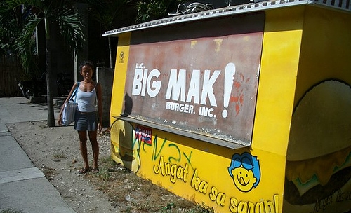 "Sign displays: ""Big Mak! Burger, Inc."""