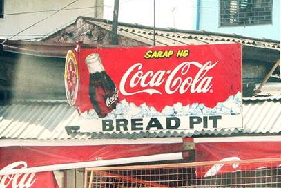 "Sign displays: ""Sarap ng Coca-Cola. Bread Pit"""