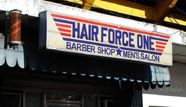 """Sign displays: """"Hair Force One Barber Shop Men's Salon"""""""