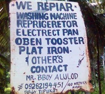 "Sign displays: ""We repiar. Washing machine. Reprigeretor. Electrect pan. Oben tooster. Plat iron. & other's. Contact Mr. Bboy Alulod"""