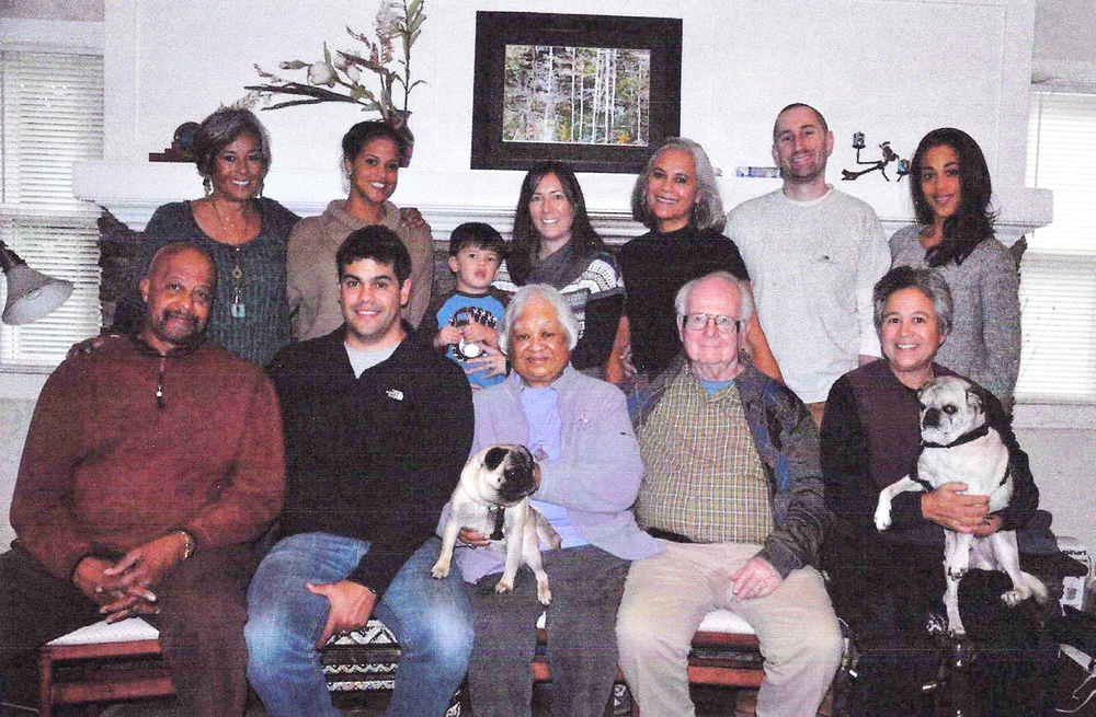 Standing (L-R) Danni Vilas, daughter, Brielle Plump, grand daughter, Zachary Isaacs, age 3 yrs, great grandson, Kimberly Isaacs, grand daughter in-law, Nikki Vilas, daughter, Trevor Ford, son-in-law, Quiana Plump, grand daughter Seated (L-R): James Plump, son-in-law, Joshua Isaacs, grandson, Vangie Buell (with dog Lois), Bill Buell, husband, Stacey Vilas, daughter (with dog Buddy) (Photo courtesy of Evangeline Canonizado Buell)