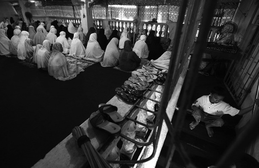 The women's section during Friday prayers at the Islamic Center Mosque in Quiapo.  (Photo by Rick Rocamora)