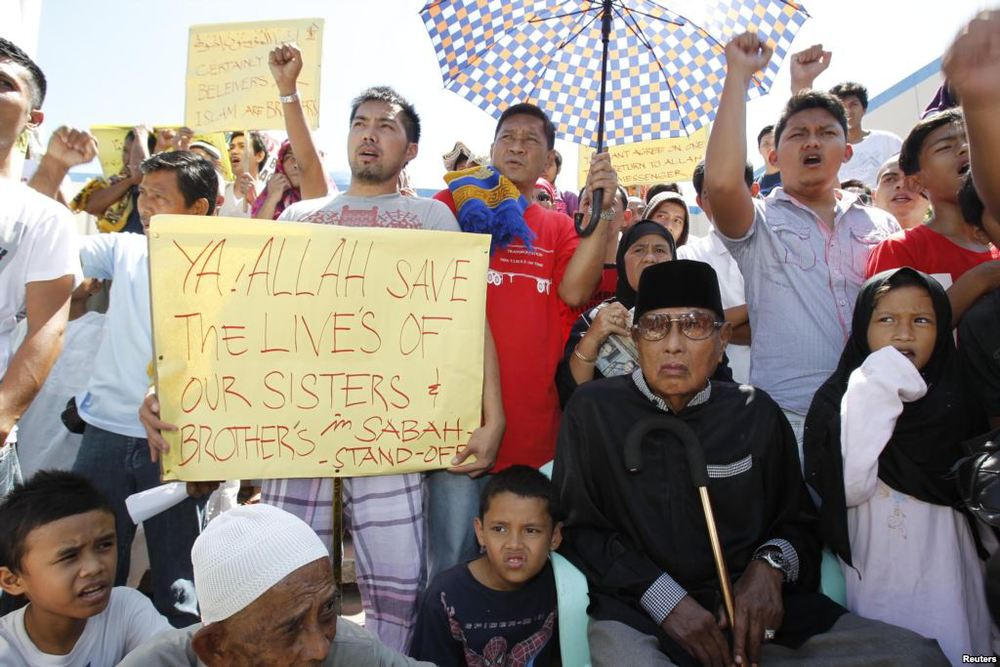 Outside the Blue Mosque in Taguig City, Philippines, Kiram and his followers stage a protest against the Malaysian police who fired upon his other followers who occupied a village in Sabah.  (Reuters)