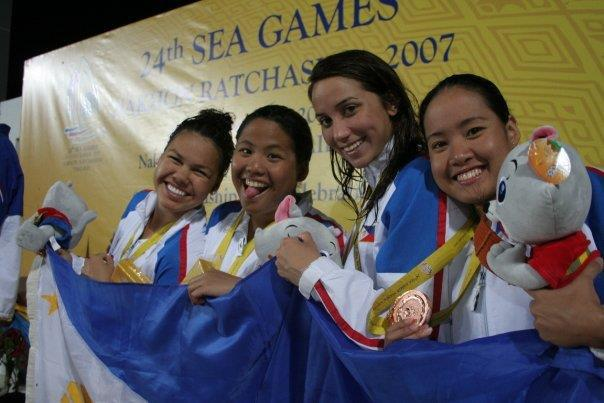 Posing on the awards podium (farthest left) after winning a bronze medal at the 2007 SEA Games in Thailand