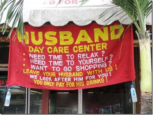 A banner outside a bar that says: Husband Day Care Center