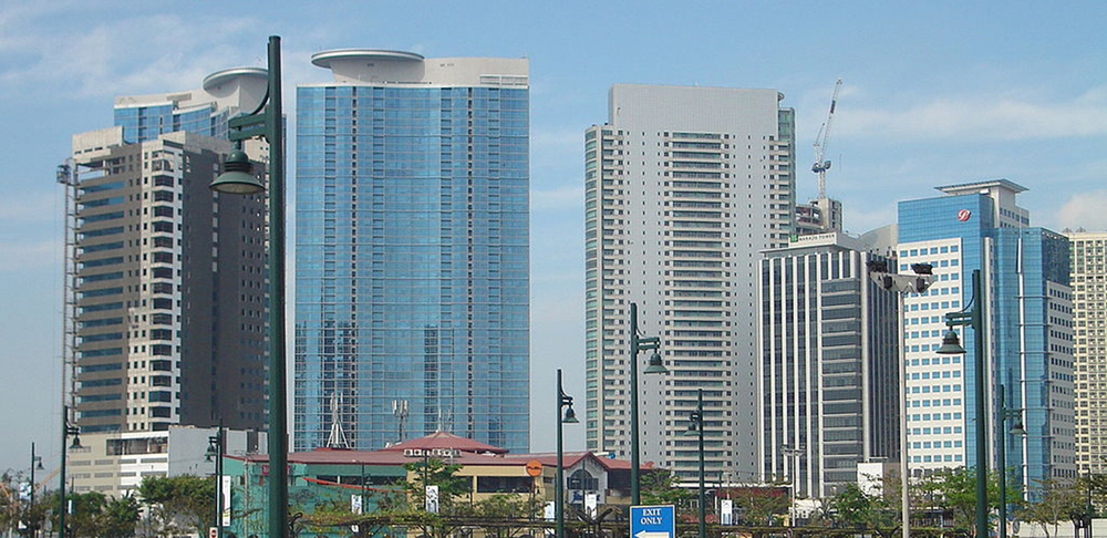 Condominiums rise up at Fort Bonifacio Global City, Philippines (Photo by Ryomaandres, Wikimedia Commons)