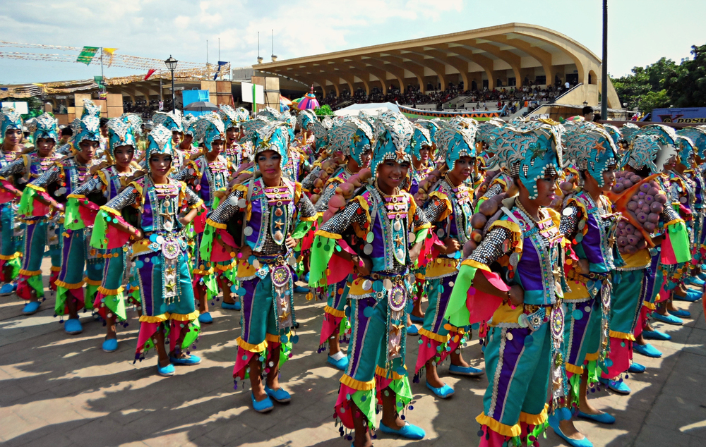Intricately costumed young men and women from the Pasaka Festival in Tanauan, Leyte add to the explosion of color at Quirino Grandstand.  (Photo by Migs Bassig)