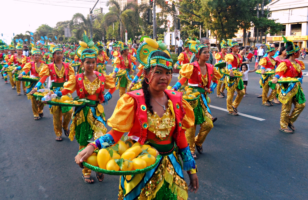 The contingent representing the Mango Festival in Zambales marches down Roxas Boulevard.  (Photo by Migs Bassig)