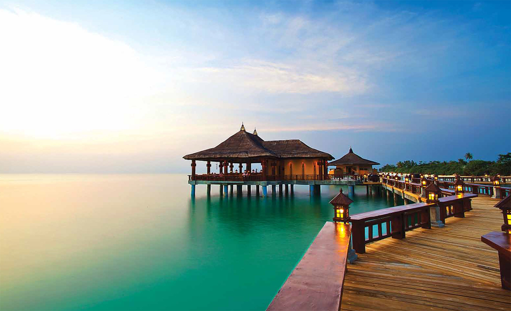 One island, seven destinations: Dinner in Italy then breakfast in Phuket? You bet. Seven hospitality villages at the Balesin Island Club offer amenities ranging from rooftop whirlpools in Mykonos Village to garden cabanas in Phuket Village. Here, stilt villas at the Bali village above the tranquil Lamon Bay  (Photo by Matthew Acred).