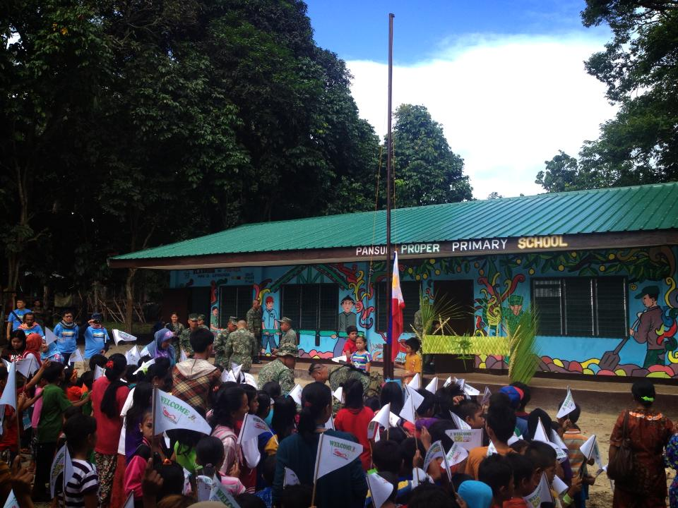 The first flag-raising event for the rise of the school built in less than a month out of the Dive-For-A-Cause effort in Patikul (Photo by Mon Corpuz)