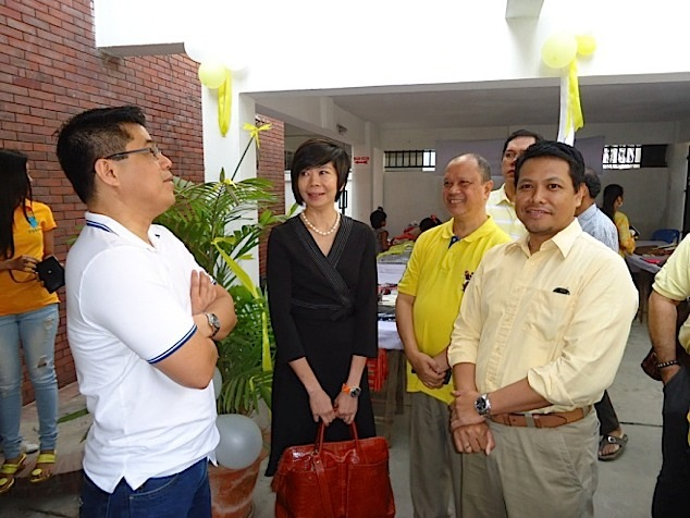 Pauline Tamesis (middle) chats with (left to right) Gabby Bordado (ILO Bangladesh), Dr. Charles Villanueva (Dean of Business School, AIUB) and Ariel Miranda (Country Director SGS). Taken during the EDSA Day Celebration, February 25, 2013 at the Philippine Embassy grounds.  (Photo courtesy of Hector Soliman)