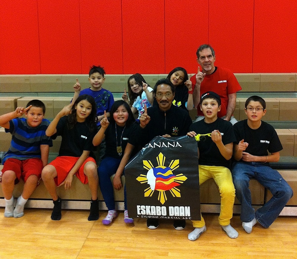 Eskabo Daan Grand Master Robert Castro (fourth from left) with students at Tanana, Alaska (Photo courtesy of Eskabo Daan)