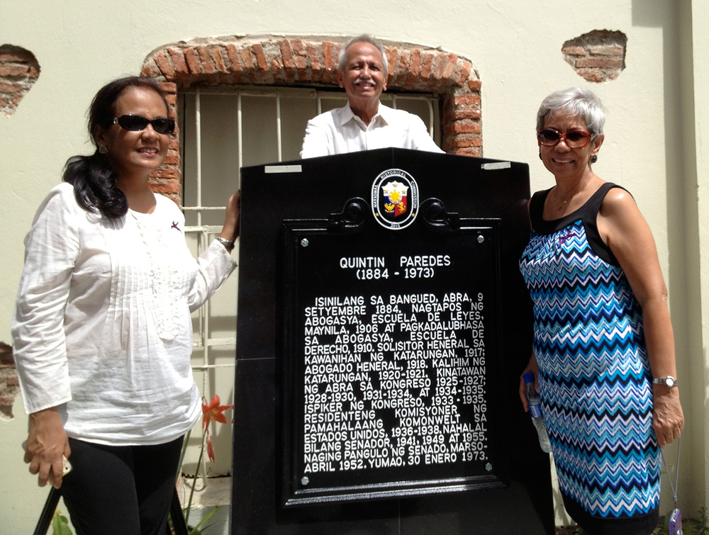 The author (right), her sister Lory Tangonan and brother Jesse Paredes pose beside the historical marker at their ancestral home in Bangued, Abra. (Photo courtesy of Paulynn and Gloria Sicam)