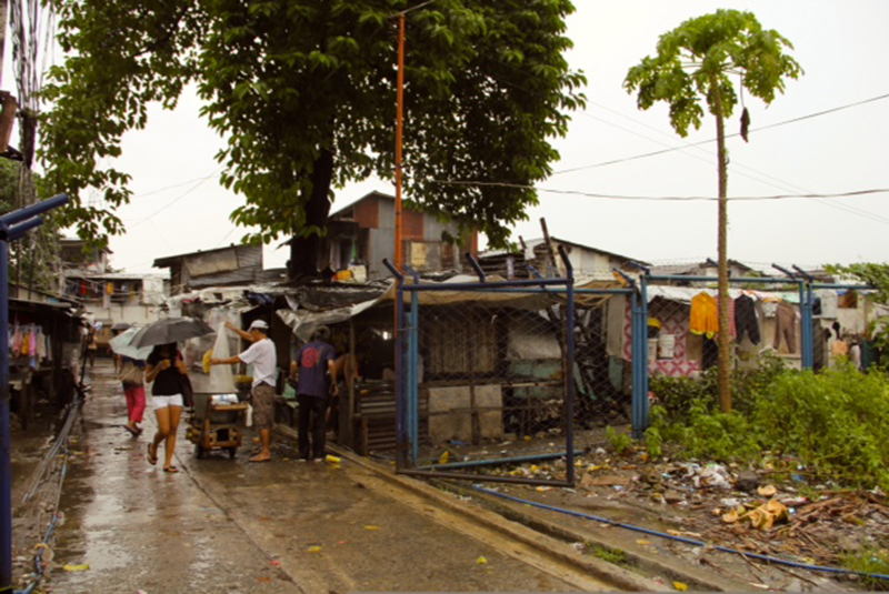 Entrance to the San Roque informal settlement in Quezon City's North Triangle. Many of Navarra's students live here.  (Photo by Aurora Almendral)