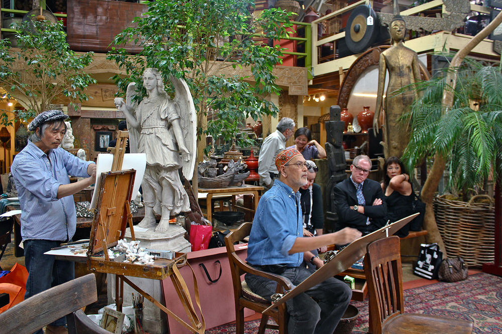 Philippine National Artist BenCab (center) sketching at a private fundraiser for Filbookfest in Richard Gervais' Souk. (Photo by France Viana)