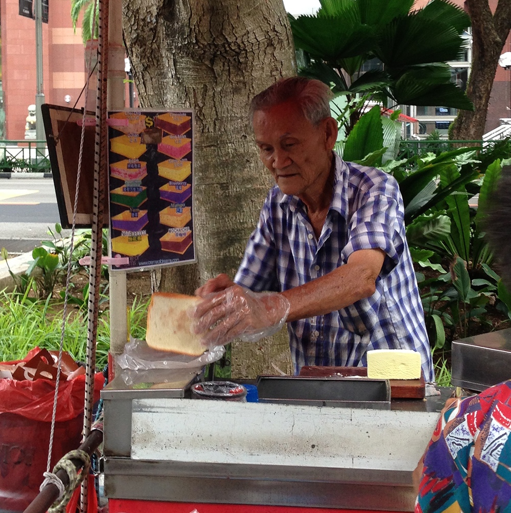 "A Singaporean ""uncle"" selling local ice cream sandwiches on Orchard Road  (Photo by Margarita Locsin)"
