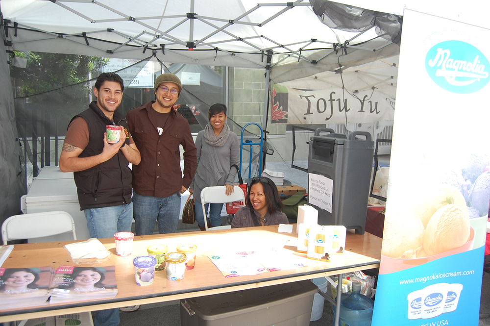 PJ and Gabe Quesada at the Magnolia booth during the Asian Heritage Street Celebration (Photo by Raymond Virata)