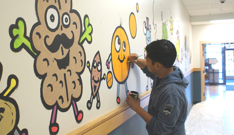 After an article in  Boston Magazine , Bataclan was commissioned to do murals at different institutions such as Boston Children's Hospital, Boston University and Lesley University. (Photo by Dawn Pakorny)