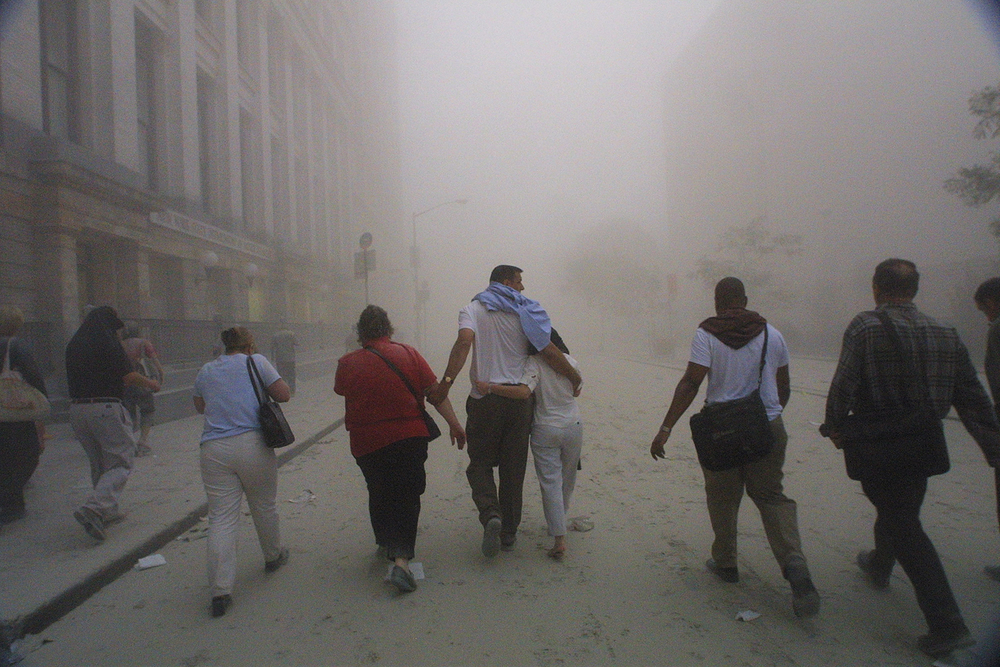 New Yorkers walk on the ash-filled streets after the World Trade Center towers fell (Source: Getty Images)