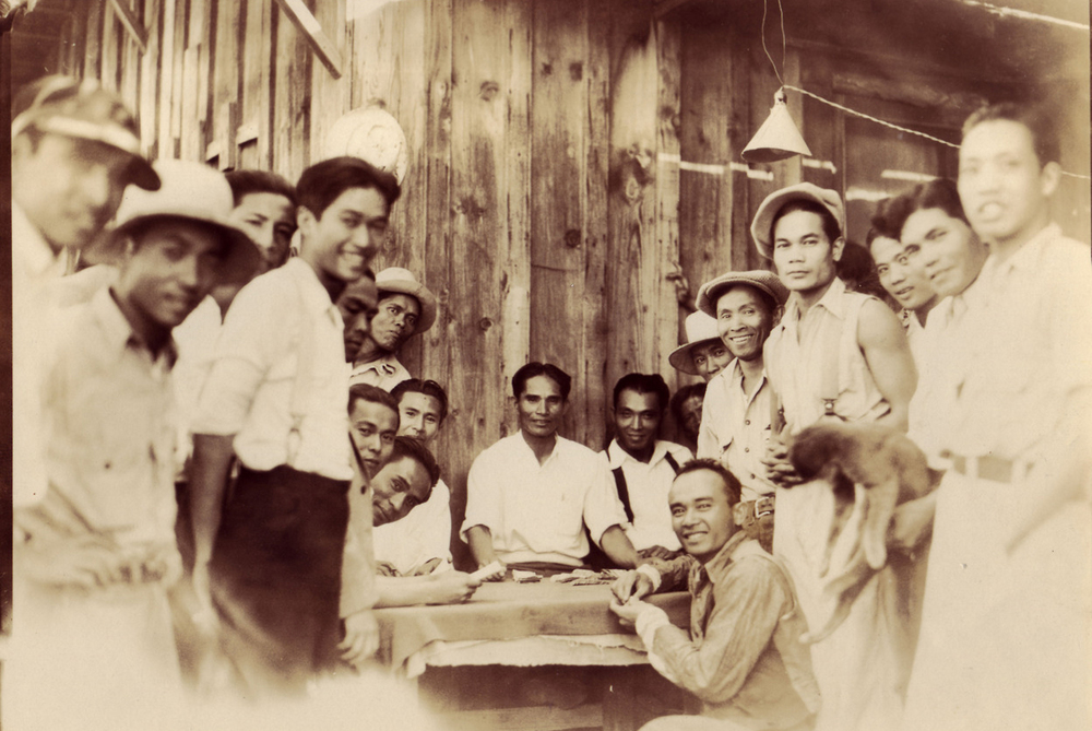 Filipinos gather to play cards in the camp after a long day in the fields, 1930s (Photo courtesy of the Filipino Oral History Project)