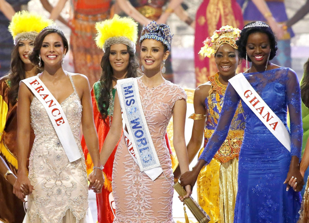 2013 Miss World Megan Young of the Philippines (center), with First Runner-up Marine Lorphelin of France (left) and Second Runner-up Naa Okailey Shooter of Ghana (Source: Efe/Epa/Made Nagi)