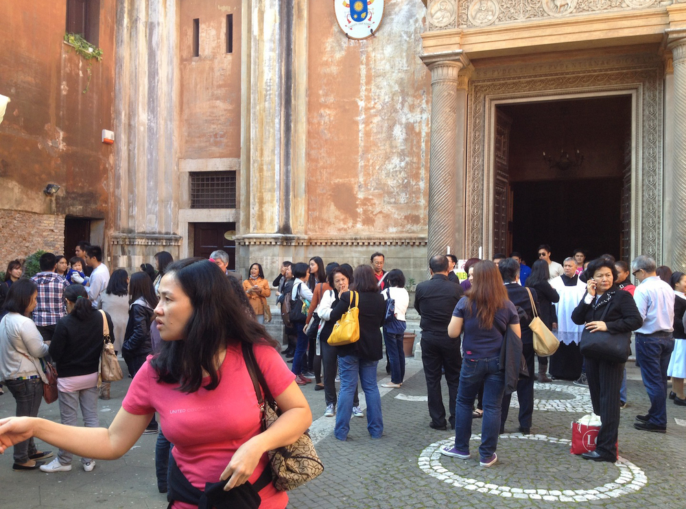 Filipinos gathered at church courtyard (Photo by John Silva)