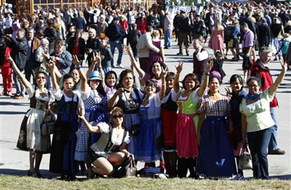 Filipinas wearing traditional Bavarian dresses at Munich's Oktoberfest  (Source: yahoo.com, photo by Reuters/Michaela Rehle)