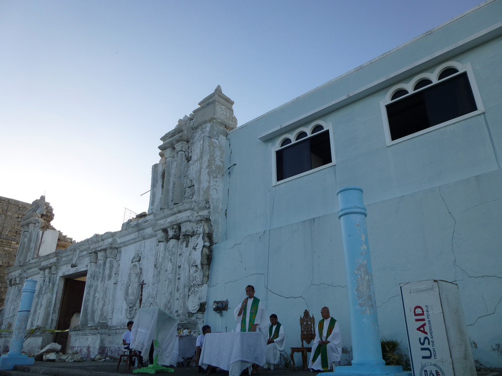 Saying mass outside the destroyed church at Guiuan, Samar.  (Photo by Criselda Yabes)