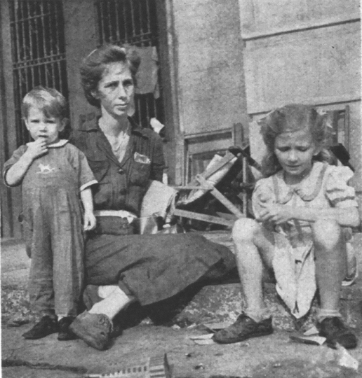 Dora Perkins and her daughter Sheila (left) and unidentified girl (right) taken after they were liberated from Santo Tomas.