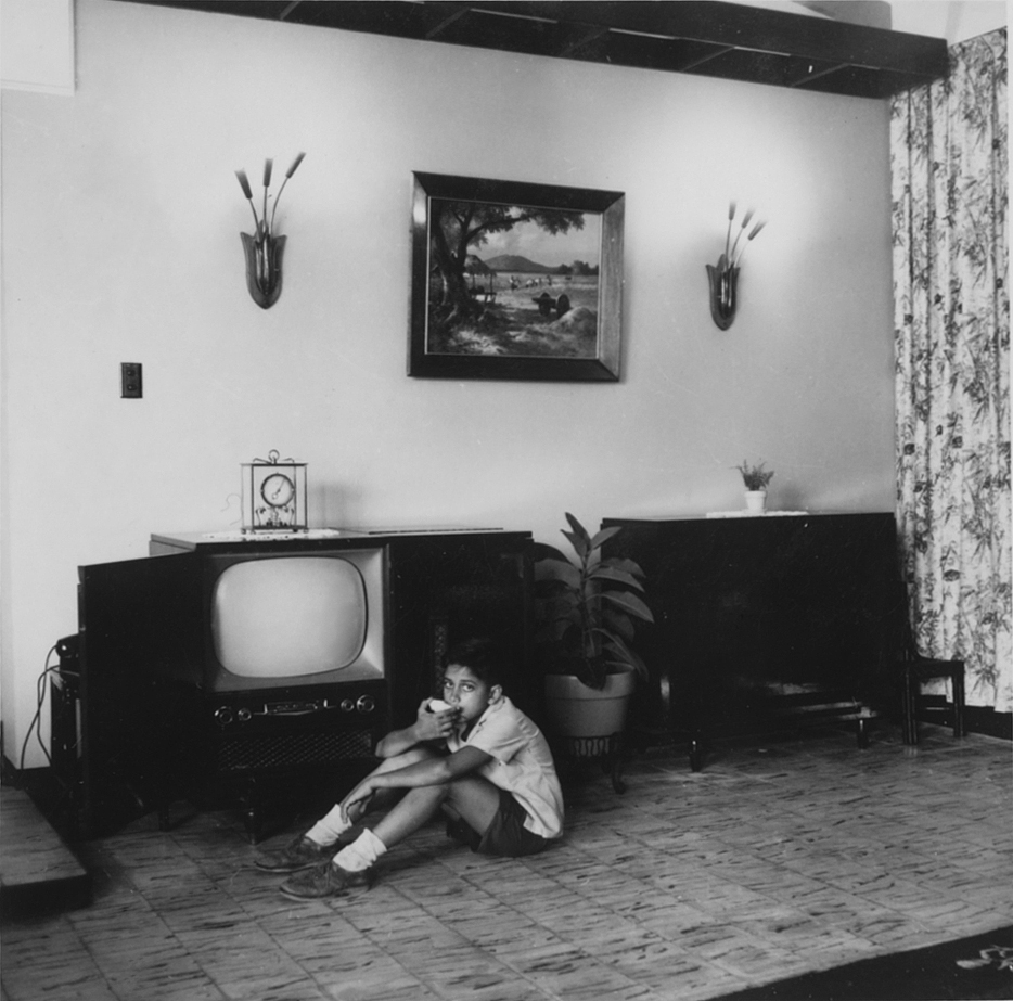 Young Lou in front of the TV console, c.1958 (Source: manilanostalgia.com)