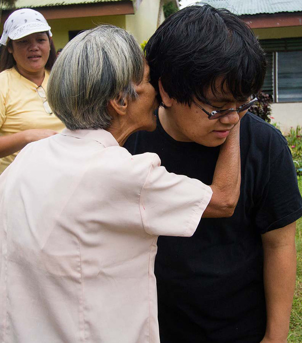 A villager expresses her gratitude to James Olivas  (Photo by Chris Yuhico)