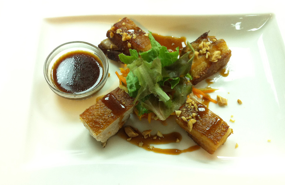 Crisp pork belly with housemade vegetable acharra and sweet soy drizzle (Photo courtesy of Chef Erwin Joven)