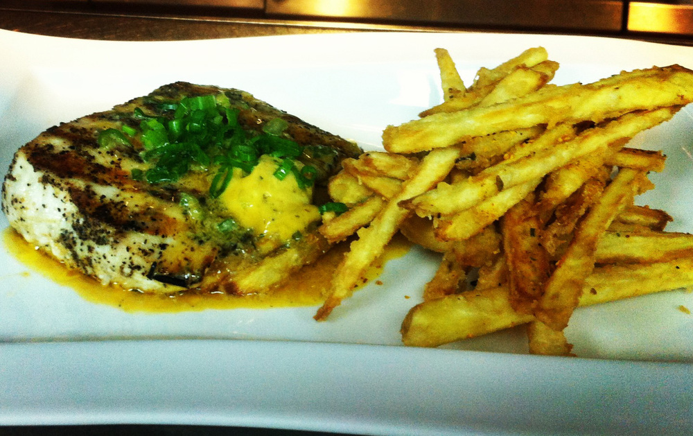 Grilled local wahoo with soy lime butter and caribbean sweet potato chips (Photo courtesy of Chef Erwin Joven)