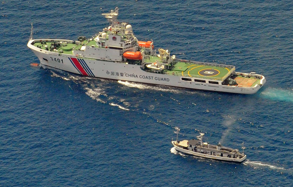 Chinese Coast Guard ships prevented Philippine supply ships from reaching the BRP Sierra Madre, the Philippine Navy's outpost in the Ayungin Shoal (Photo by AFP/Jay Directo)