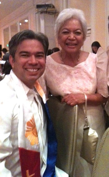 The Bontas share a laugh in the spotlight at a Filipina Women's Network gala. (Photo courtesy of Cynthia Bonta)